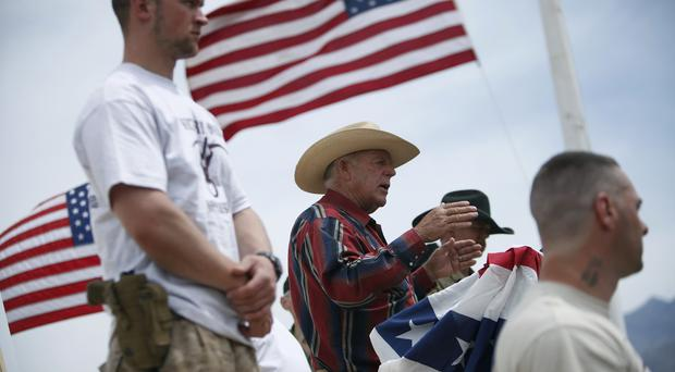 Cliven Bundy, centre, speaking at a protest camp in Nevada (Las Vegas Review-Journal/AP)