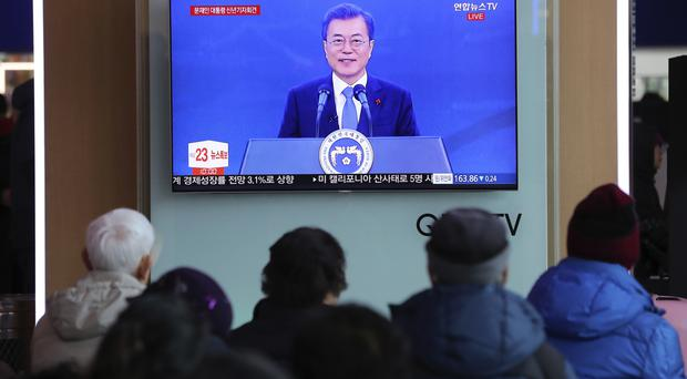 People watch a live broadcast of South Korean President Moon Jae-in's New Year's speech on Wednesday (AP/Lee Jin-man)