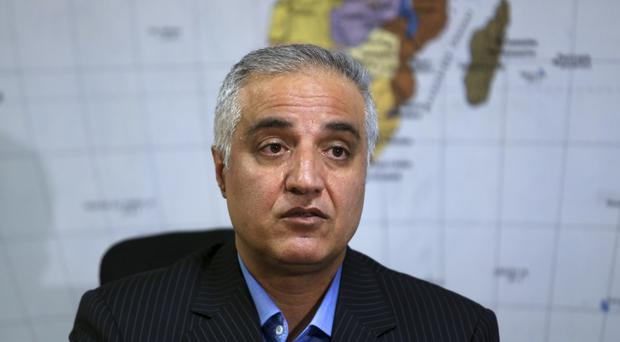 Mohsen Bahrami, of the National Iranian Tanker Company, whose oil tanker burst into flames after a collision in the East China Sea, said there is still hope of finding survivors (AP Photo/Vahid Salemi)