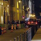 French police at the scene outside the Ritz Hotel (AP)