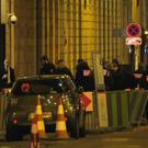 Police gathered outside the Ritz Hotel in Paris (AP)