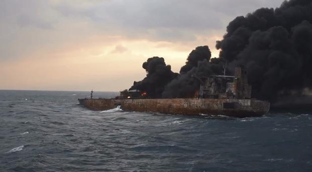 Smoke rises from a fire on board the oil tanker Sanchi in the East China Sea