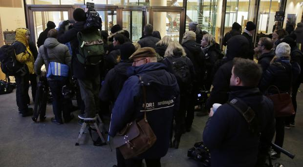 Journalists queue outside the Social Democrats' party headquarters in Berlin after talks with Angela Merkel's Christian Democrats on forming a new German government (AP Photo/Markus Schreiber)