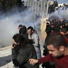 Police fire tear gas at protesters on the steps of parliament in Athens (AP)