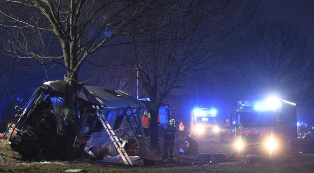 Rescue workers and firemen at the site of a fatal bus crash in Horomerice near Prague (AP)