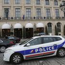 A police car drives past the Ritz hotel in Paris (Michel Euler/AP)