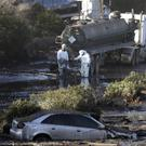 Crews pump mud on Highway 101 in Montecito, California (AP/Marcio Jose Sanchez)