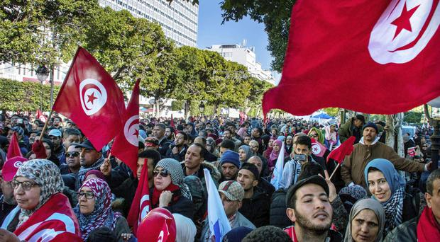 Tunisian government hoping days of protests are subsiding