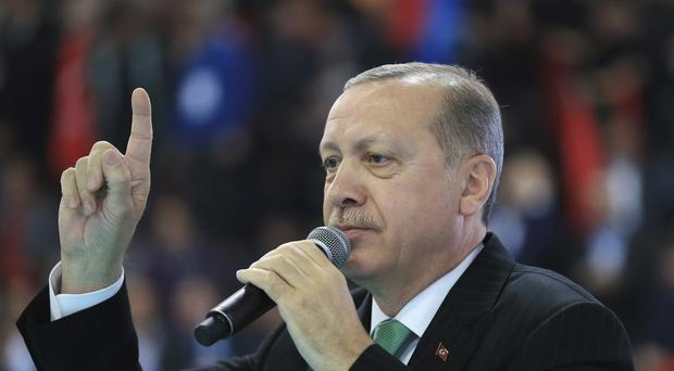 Mr Erdogan has lashed out at the US over the border force move (AP)