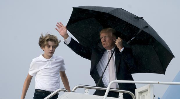 President Donald Trump and his son Barron board Air Force One at Palm Beach International Airport (AP)