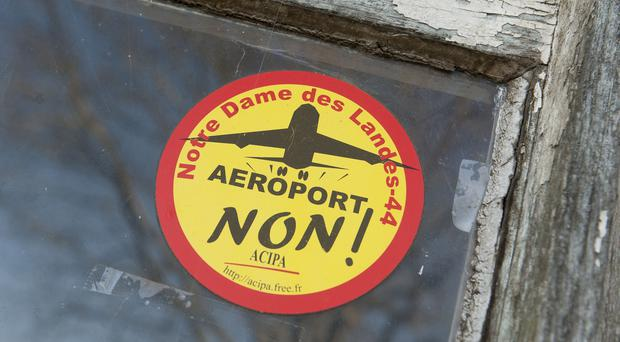 """A sticker reading """"No to the airport"""" is pasted on the window of a farm (AP)"""