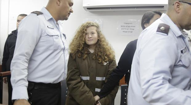 Ahed Tamimi is brought to a courtroom inside the Ofer military prison near Jerusalem (AP)