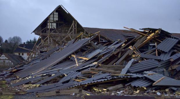 A farm building collapses during a heavy storm in Meimbressen, central Germany (Uwe Zucchi/dpa/AP)