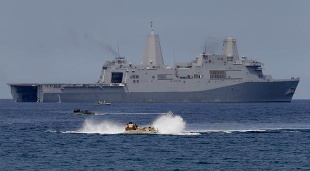 The US Navy operating in the South China Sea (Bullit Marquez/AP)