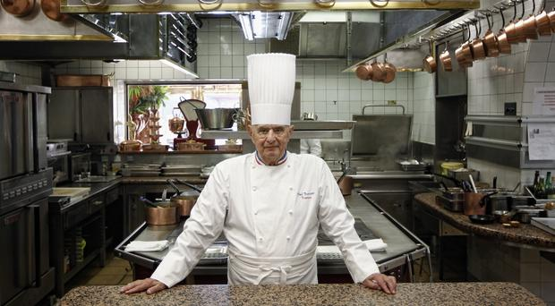 French Chef Paul Bocuse poses outside his famed Michelin three-star restaurant L'Auberge du Pont de Collonges (Laurent Cipriani/AP)