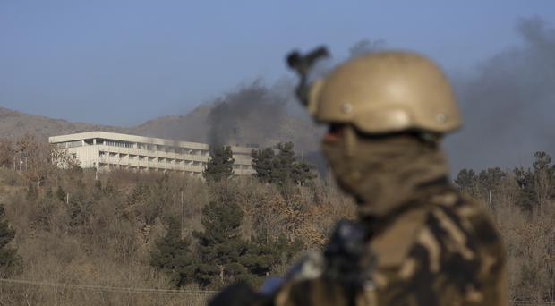 Black smoke rises from the Intercontinental Hotel after an attack in Kabul (Rahmat Gul/AP)