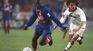 George Weah pictured during his playing days with Paris St-Germain (Lionel Cironneau/AP)