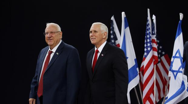 US vice president Mike Pence, right, walks alongside Israel President Reuven Rivlin (Ronen Zvulun/AP)