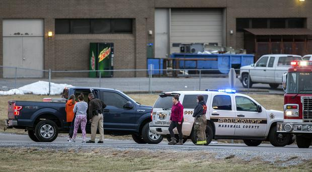 Marshall County High School students are escorted by police after the deadly shooting (AP)