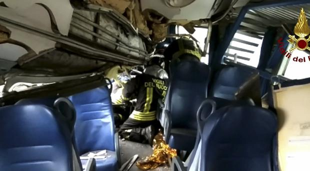 Rescuers at work in the train wreckage (Fire Service/AP)