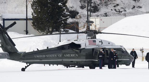 Donald Trump leaves Marine One after arriving in Davos (Gian Ehrenzeller/AP)