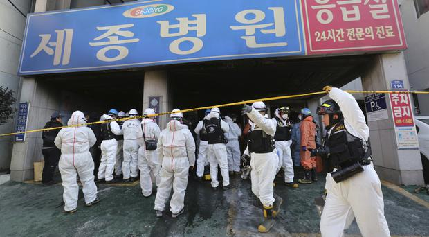 Police investigators prepare to inspect the site (Ahn Young-joon/AP)