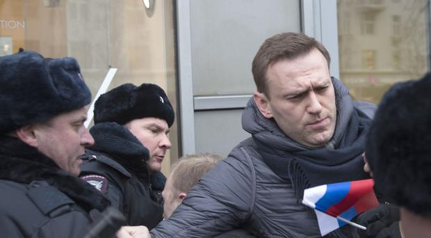 Alexei Navalny is detained by police (Evgeny Feldman/AP)