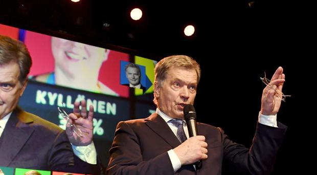 Sauli Niinisto speaks to supporters on election night (Jussi Nukari/AP)