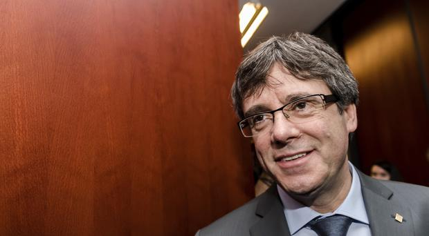 Mr Puigdemont is seeking re-election as Catalan leader (AP)