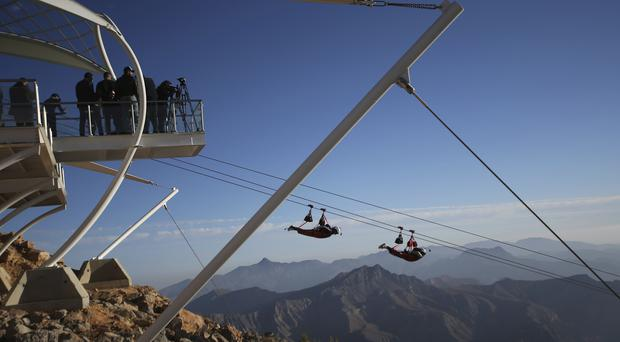 Thrill-seekers ride on the record-breaking zipline (AP)