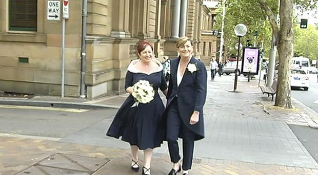 Christine Forster, right, walks with her partner Virginia Edwards (Australian Broadcasting Corp/AP)