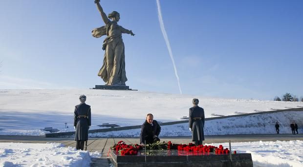 Vladimir Putin lays a wreath in Volgograd, formerly Stalingrad (Maxim Shemetov/AP)