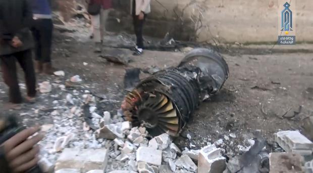Part of a Russian plane that was shot down by rebel fighters over Syria (Ibaa News Agency via AP)