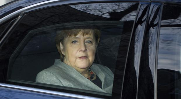 German Chancellor Angela Merkel arrives at the headquarters of the Social Democratic party in Berlin (AP)