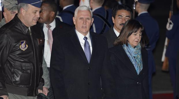 Mike Pence and his wife Karen arrive in Japan (AP)