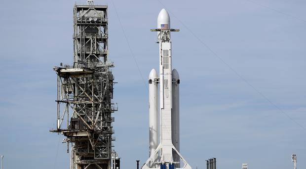 A Falcon 9 SpaceX heavy rocket stands ready for launch on pad 39A at the Kennedy Space Centre (Terry Renna/AP)