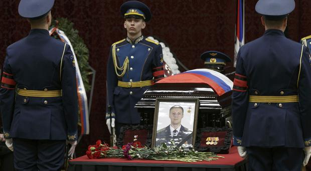 Honorary guards stand next to the coffin of Roman Filipov (Vadim Savitsky/Pool Photo via AP)
