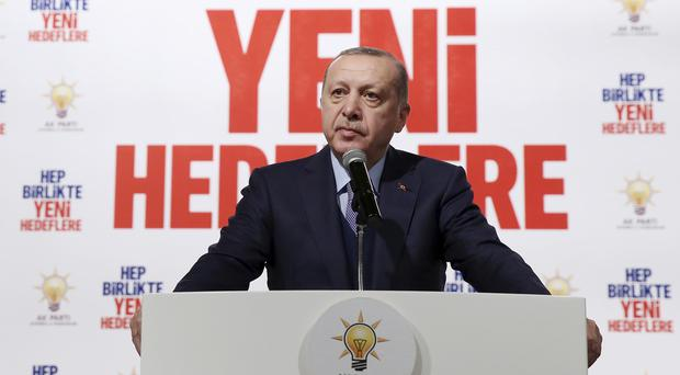 Turkey's President Erdogan said a Turkish military helicopter was 'downed' in Syria (Murat Cetinmuhurdar/Pool Photo via AP)