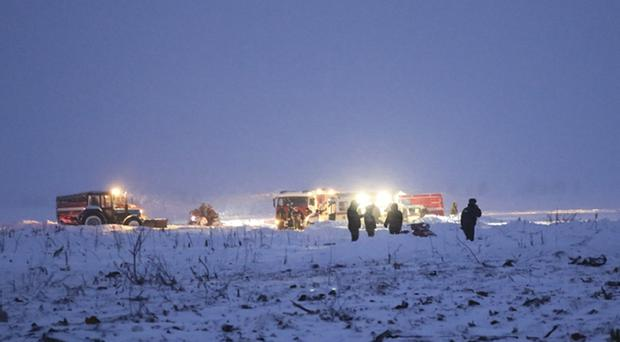 Rescue workers at the scene of the crash (AP)