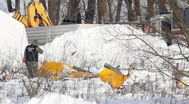 A man looks at wreckage near the scene of the AN-148 plane crash in Stepanovskoye village (AP)