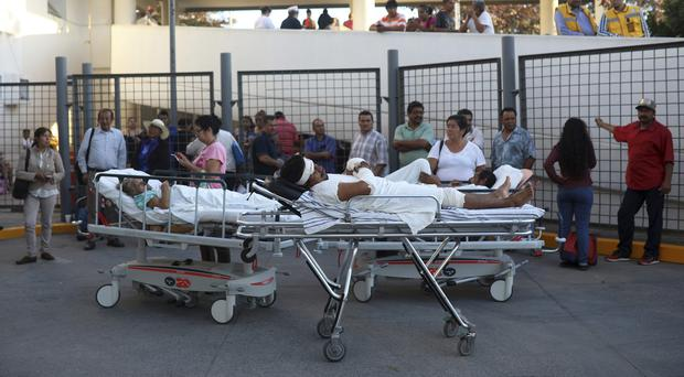 Patients outside the General Hospital in Veracruz, Mexico, after they were evacuated following a powerful quake (Felix Marquez/AP)