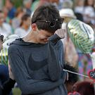 Daniel Bishop, 16, a student at Marjory Stoneman Douglas High School, cries at a makeshift memorial outside the school (AP Photo/Gerald Herbert)