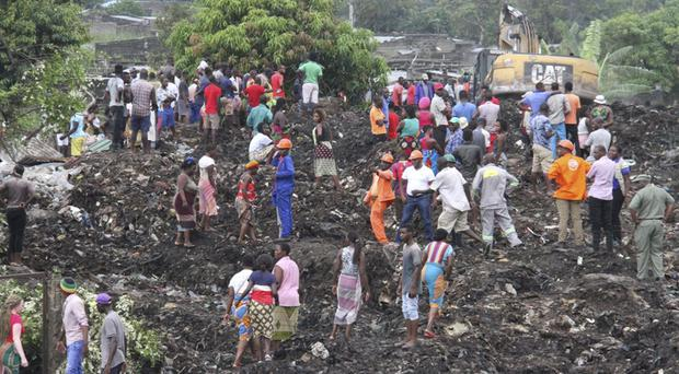 Rescuers search for survivors at the collapse site in Maputo (AP)
