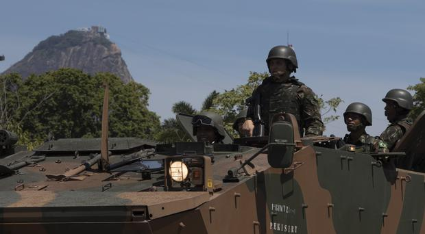 Troops in Rio de Janeiro with the Sugar Loaf mountain in the background (Leo Correa/AP)