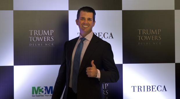 Donald Trump Jr. gives a thumbs up as he arrives for a meeting in New Delhi (AP)