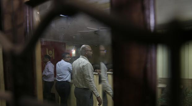 Officials of the Central Bureau of Investigation and bank staff stand inside during a raid at the Punjab National Bank (AP)