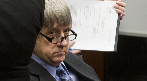 David Turpin appeared in court alongside his wife (Damian Dovarganes/AP)