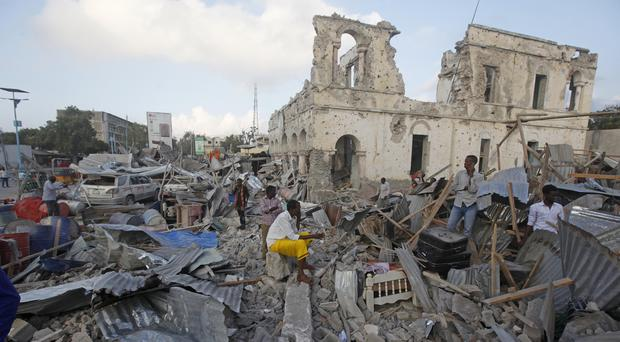 The scene after a twin car bomb attack in Mogadishu (AP Photo/Farah Abdi Warsameh)