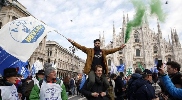 The League party's activists at a rally in Milan (AP Photo/Antonio Calanni)