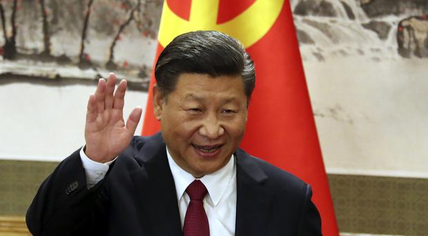 Chinese President Xi Jinping could extend his grip on power as the Chinese parliament looks at removing two-term limits for presidents (AP)